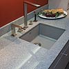 Luzerner Grau – countersunk drain board with incline towards sink.